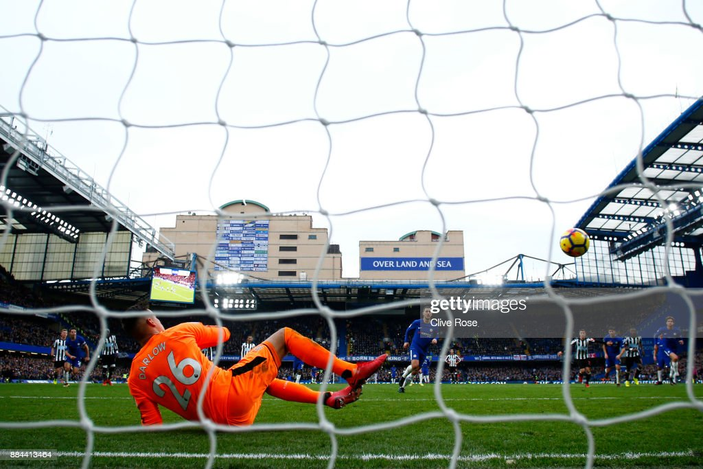 Eden Hazard of Chelsea scores his sides third goal from the penalty spot past Karl Darlow of Newcastle United during the Premier League match between Chelsea and Newcastle United at Stamford Bridge on December 2, 2017 in London, England.