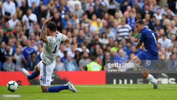 Eden Hazard of Chelsea scores his team's first goal during the Premier League match between Chelsea FC and Cardiff City at Stamford Bridge on...