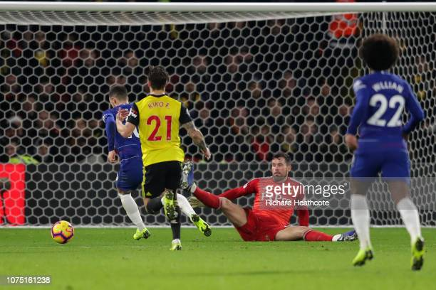 Eden Hazard of Chelsea scores his team's first goal past Ben Foster of Watford during the Premier League match between Watford FC and Chelsea FC at...