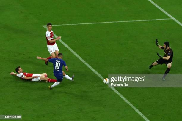 Eden Hazard of Chelsea scores his team's fourth goal past Petr Cech of Arsenal during the UEFA Europa League Final between Chelsea and Arsenal at...