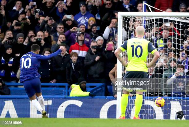 Eden Hazard of Chelsea scores his team's second goal from the penalty spot during the Premier League match between Chelsea FC and Huddersfield Town...