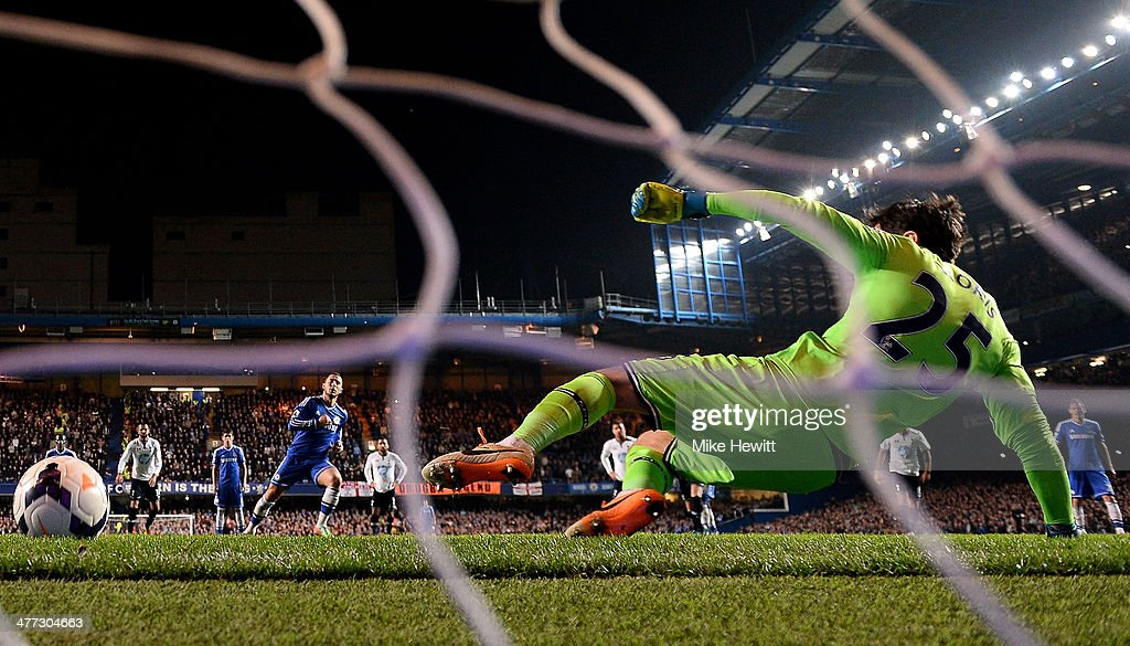 Eden Hazard of Chelsea scores his team's second goal from the penalty spot past goalkeeper Hugo Lloris of Spurs during the Barclays Premier League match between Chelsea and Tottenham Hotspur at Stamford Bridge on March 8, 2014 in London, England.