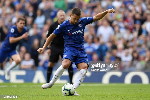Eden Hazard of Chelsea scores his team's third goal from a penalty during the Premier League match between Chelsea FC and Cardiff City at Stamford...