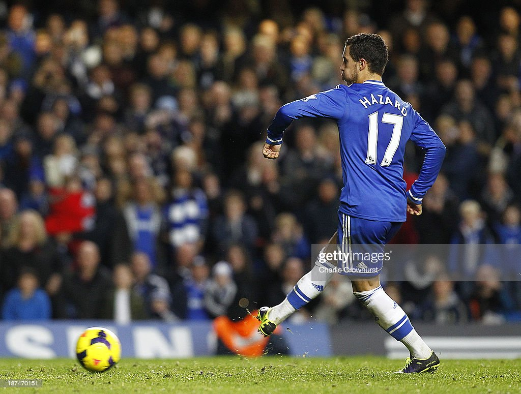 Eden Hazard of Chelsea scores the equaliser from the penalty spot during the Barclays Premier League match between Chelsea and West Bromwich Albion at Stamford Bridge on November 09, 2013 in London, England.