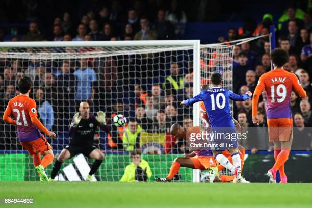 Eden Hazard of Chelsea scores the first goal during the Premier League match between Chelsea and Manchester City at Stamford Bridge on April 5 2017...
