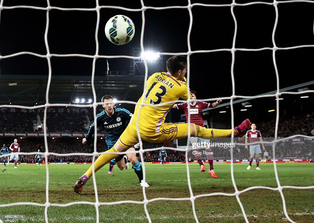 Eden Hazard of Chelsea scores the opening goal by heading the ball past goalkeeper Adrian of West Ham during the Barclays Premier League match between West Ham and Chelsea at the Boleyn Ground on March 4, 2015 in London, England.