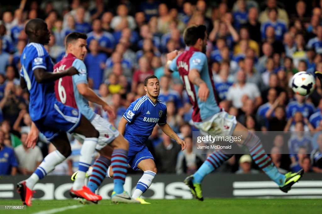 Eden Hazard (C) of Chelsea scores the opening goal during the Barclays Premier League match between Chelsea and Aston Villa at Stamford Bridge on August 21, 2013 in London, England.