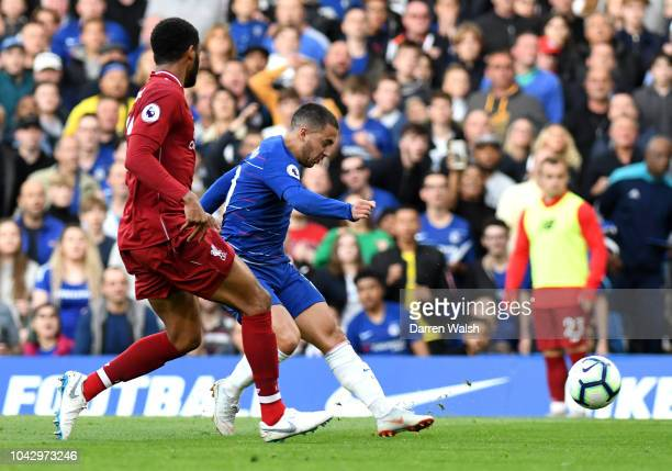 Eden Hazard of Chelsea scores the opening goal during the Premier League match between Chelsea FC and Liverpool FC at Stamford Bridge on September 29...