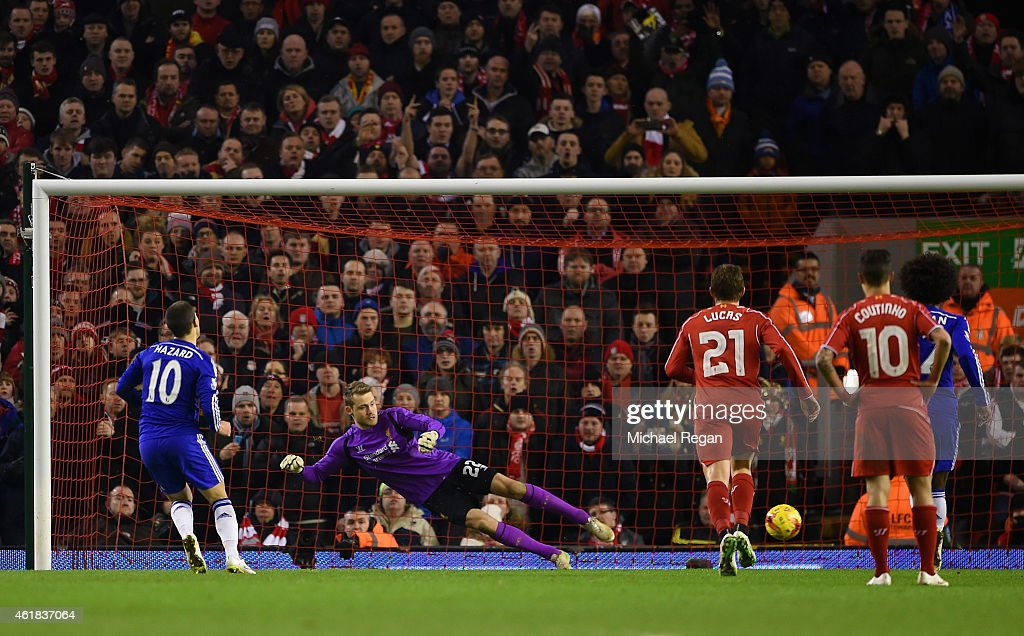 Eden Hazard of Chelsea scores the opening goal past Simon Mignolet of Liverpool from the penalty spot during the Capital One Cup Semi-Final first leg match between Liverpool and Chelsea at Anfield on January 20, 2015 in Liverpool, England.