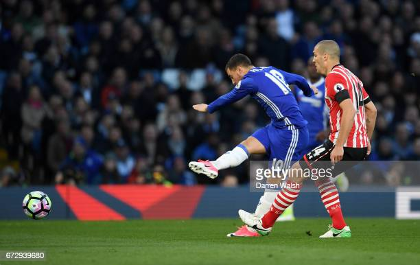 Eden Hazard of Chelsea scores their first goal during the Premier League match between Chelsea and Southampton at Stamford Bridge on April 25 2017 in...