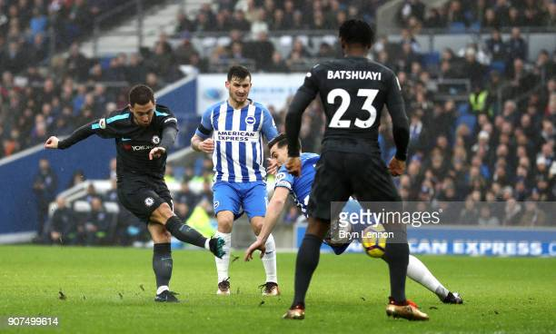 Eden Hazard of Chelsea scores their first goal during the Premier League match between Brighton and Hove Albion and Chelsea at Amex Stadium on...
