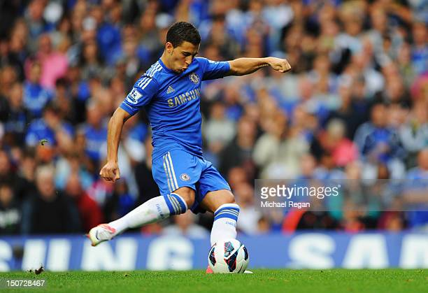 Eden Hazard of Chelsea scores their first goal from the penalty spot during the Barclays Premier League match between Chelsea and Newcastle United at...