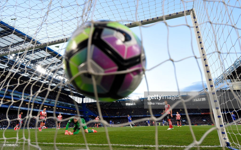 Eden Hazard of Chelsea scores their first goal past goalkeeper Fraser Forster of Southampton during the Premier League match between Chelsea and Southampton at Stamford Bridge on April 25, 2017 in London, England.