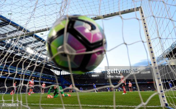 Eden Hazard of Chelsea scores their first goal past goalkeeper Fraser Forster of Southampton during the Premier League match between Chelsea and...