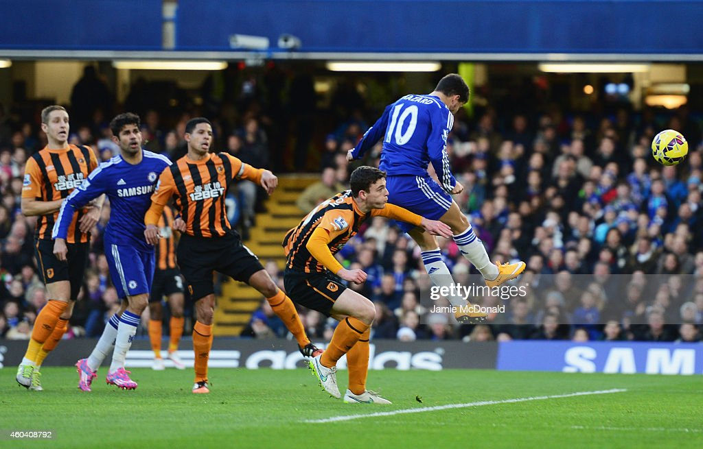 Eden Hazard of Chelsea (10) scores their first goal with a header during the Barclays Premier League match between Chelsea and Hull City at Stamford Bridge on December 13, 2014 in London, England.