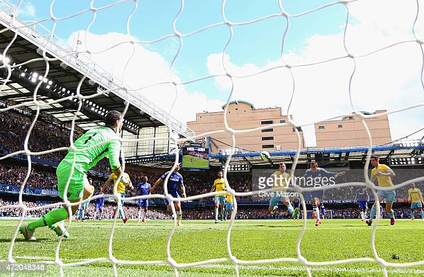 Eden Hazard of Chelsea scores their first goal with a header past Julian Speroni of Crystal Palace during the Barclays Premier League match between...