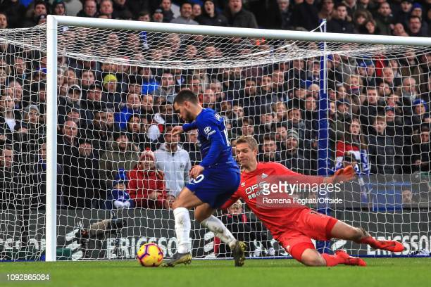 Eden Hazard of Chelsea scores their third goal during the Premier League match between Chelsea FC and Huddersfield Town at Stamford Bridge on...