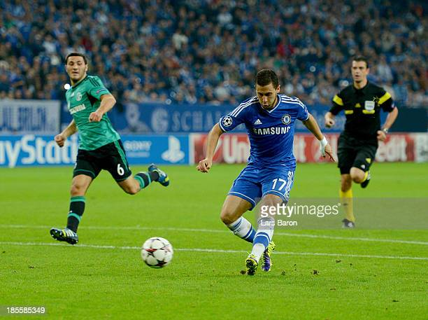 Eden Hazard of Chelsea scores their third goal during the UEFA Champions League Group E match between FC Schalke 04 and Chelsea at VeltinsArena on...