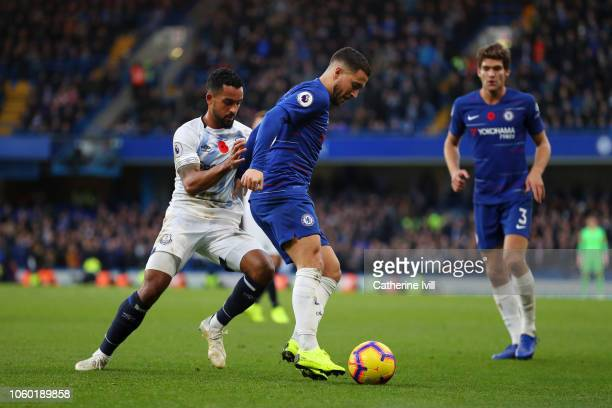 Eden Hazard of Chelsea shields the ball from Theo Walcott of Everton during the Premier League match between Chelsea FC and Everton FC at Stamford...
