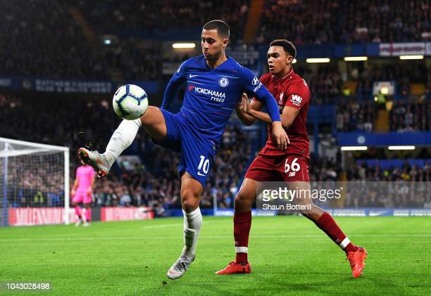 Eden Hazard of Chelsea shields the ball from Trent AlexanderArnold of Liverpool during the Premier League match between Chelsea FC and Liverpool FC...