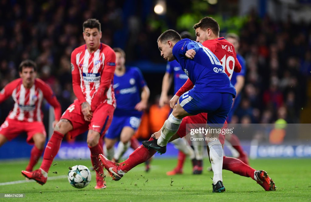 Eden Hazard of Chelsea shoots and his shot is deflected in by Stefan Savic of Atletico Madrid for Chelsea first goal during the UEFA Champions League group C match between Chelsea FC and Atletico Madrid at Stamford Bridge on December 5, 2017 in London, United Kingdom.