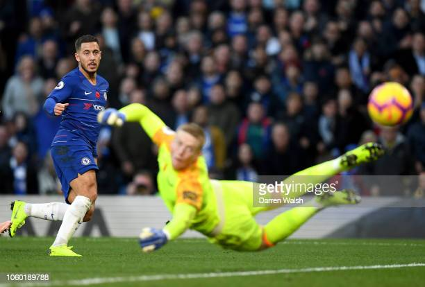 Eden Hazard of Chelsea shoots as Jordan Pickford of Everton watches the shot during the Premier League match between Chelsea FC and Everton FC at...