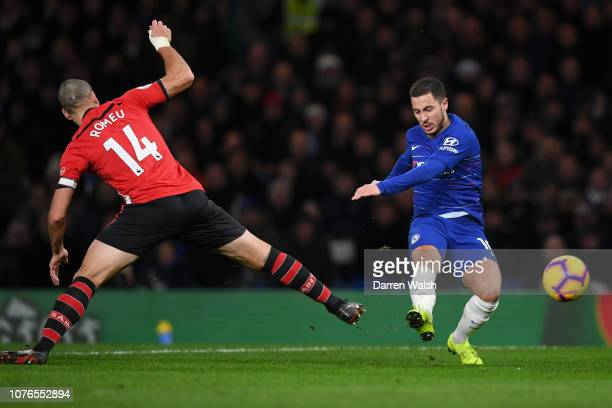 Eden Hazard of Chelsea shoots as Oriol Romeu of Southampton looks on during the Premier League match between Chelsea FC and Southampton FC at...