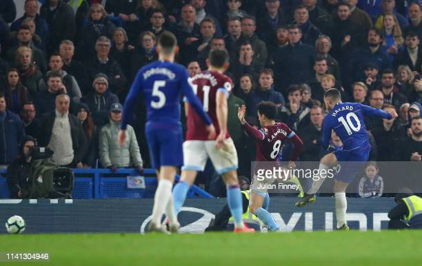 Eden Hazard of Chelsea shoots past Felipe Anderson of West Ham United as he scores his team's second goal during the Premier League match between...