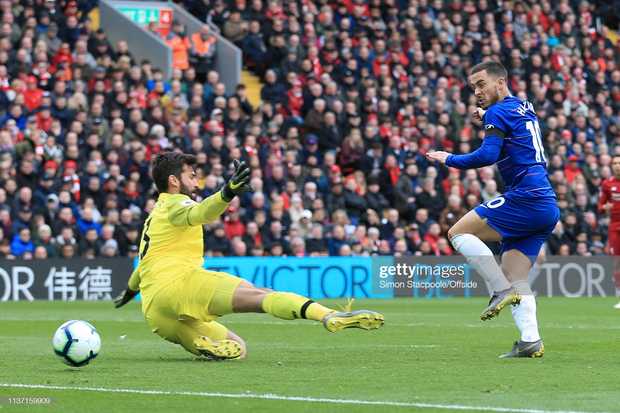 https://media.gettyimages.com/photos/eden-hazard-of-chelsea-shoots-past-liverpool-goalkeeper-alisson-but-picture-id1137159909?s=2048x2048