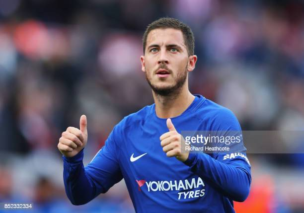 Eden Hazard of Chelsea shows appreciation to the fans after the Premier League match between Stoke City and Chelsea at Bet365 Stadium on September 23...