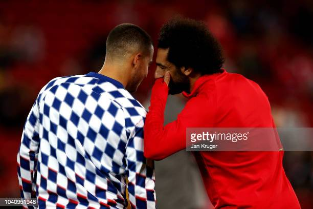 Eden Hazard of Chelsea speaks to Mohamed Salah of Liverpool ahead of the Carabao Cup Third Round match between Liverpool and Chelsea at Anfield on...