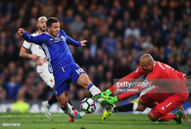 Eden Hazard of Chelsea stretches to get a touch on the ball as Heurelho Gomes of Watford comes to collect it during the Premier League match between...
