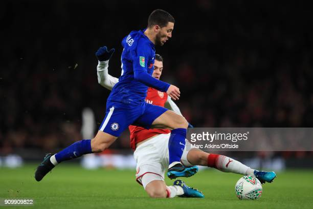 Eden Hazard of Chelsea tackled by Granit Xhaka of Arsenal during the Carabao Cup SemiFinal 2nd leg match between Arsenal and Chelsea at Emirates...