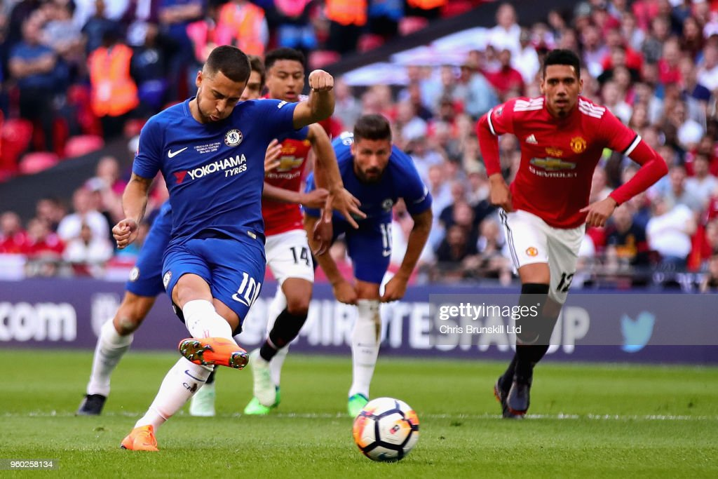 Eden Hazard of Chelsea takes a penalty and scores his sides first goal during the Emirates FA Cup Final between Chelsea and Manchester United at Wembley Stadium on May 19, 2018 in London, England.
