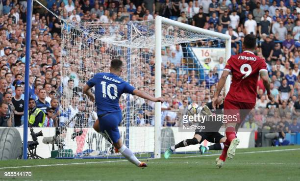 Eden Hazard of Chelsea takes a shot at goal saved by Loris Karius of Liverpool during English Premier League match between Chelsea and Liverpool at...