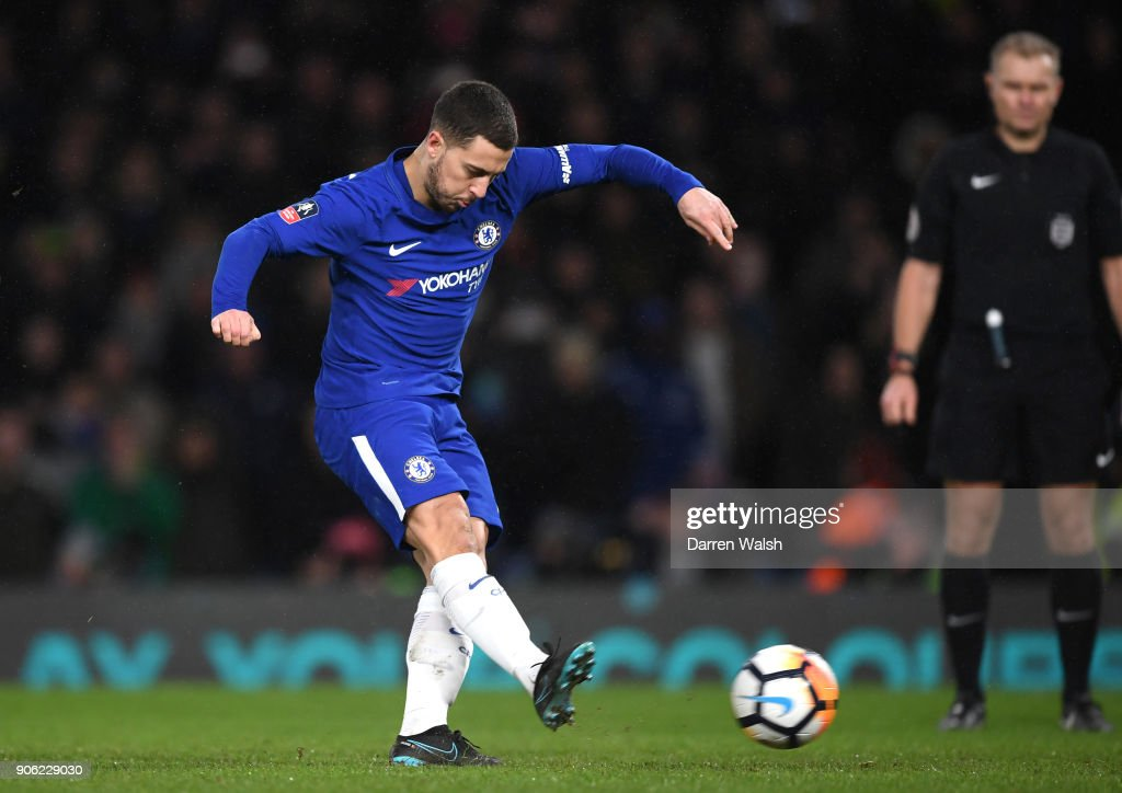 Eden Hazard of Chelsea takes and scores the winning penalty during The Emirates FA Cup Third Round Replay between Chelsea and Norwich City at Stamford Bridge on January 17, 2018 in London, England.