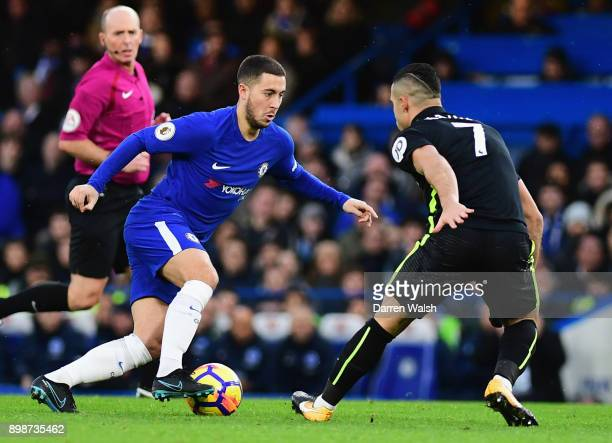 Eden Hazard of Chelsea takes on Biram Kayal of Brighton and Hove Albion during the Premier League match between Chelsea and Brighton and Hove Albion...