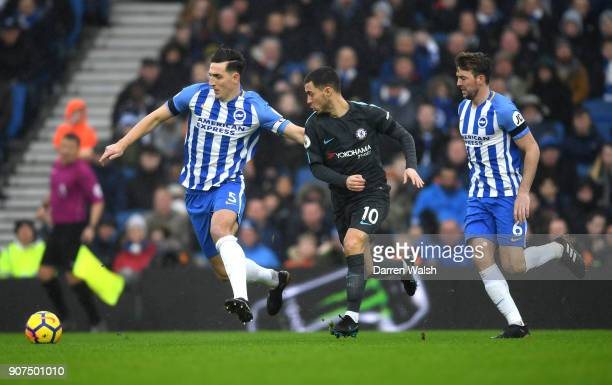 Eden Hazard of Chelsea takes on Lewis Dunk and Dale Stephens of Brighton and Hove Albion during the Premier League match between Brighton and Hove...