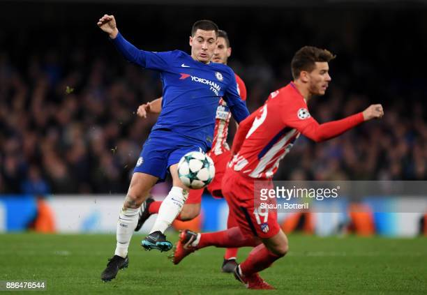 Eden Hazard of Chelsea takes on Lucas Hernandez of Atletico Madrid during the UEFA Champions League group C match between Chelsea FC and Atletico...