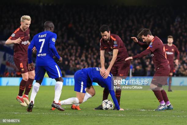 Eden Hazard of Chelsea tangles with Sergio Busquets of FC Barcelona as N'Golo Kante Ivan Rakitic and Lionel Messi look on during the UEFA Champions...
