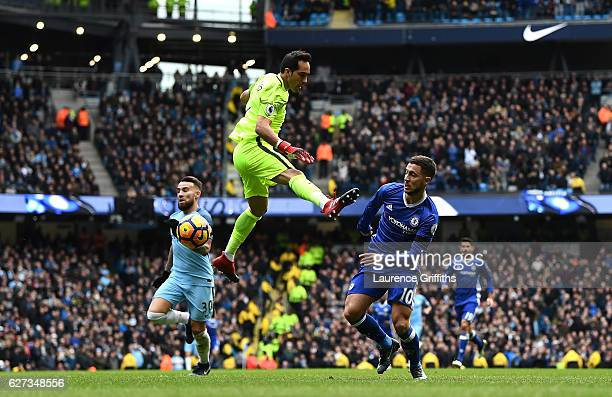 Eden Hazard of Chelsea tries to go past Claudio Bravo of Manchester City during the Premier League match between Manchester City and Chelsea at...