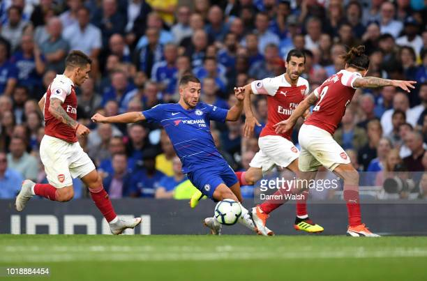 Eden Hazard of Chelsea turns with the ball under pressure from Lucas Torreira Henrikh Mkhitaryan Hector Bellerin of Arsenal during the Premier League...