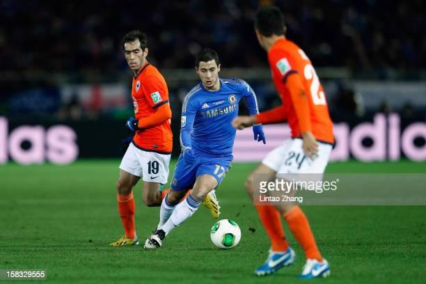 Eden Hazard of Chelsea weaves around Cesar Delgado and Sergio Perez of Monterrey during the FIFA Club World Cup Semi Final match between CF Monterrey...