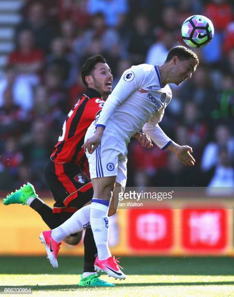 Eden Hazard of Chelsea wins a header over Adam Smith of AFC Bournemouth during the Premier League match between AFC Bournemouth and Chelsea at...