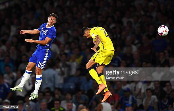 Eden Hazard of Chelsea wins a header with Daniel Leadbitter of Bristol Rovers during the EFL Cup second round match between Chelsea and Bristol...