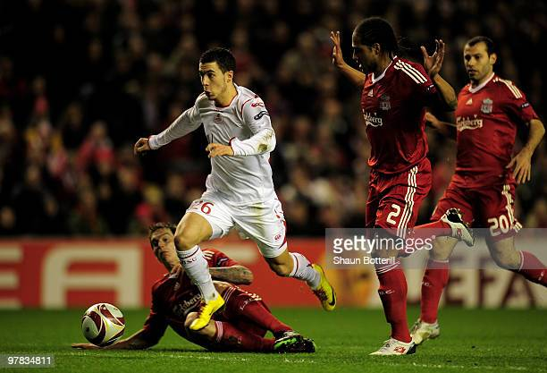 Eden Hazard of Lille breaks clear of the challenges of Daniel Agger and Glen Johnson of Liverpool during the UEFA Europa League Round of 16 second...