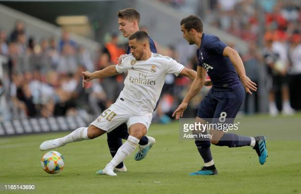 Eden Hazard of Madrid challenges Harry Billy Winks of Tottenham during the Audi Cup 2019 semi final match between Real Madrid and Tottenham Hotspur...