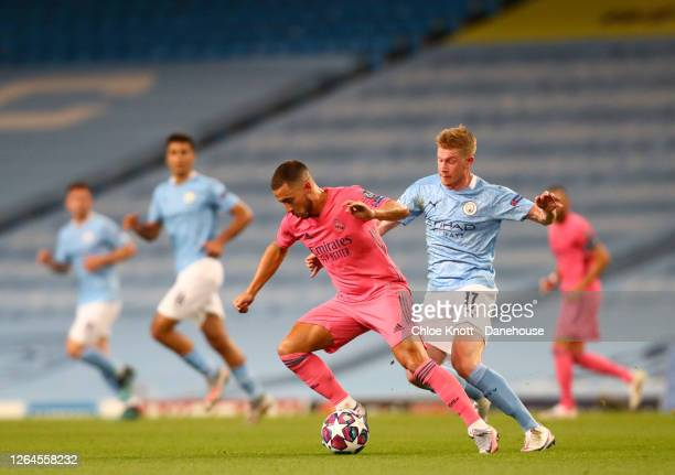 Eden Hazard of Real Madrid and Kevin De Bruyne of Manchester City in action during the UEFA Champions League round of 16 second leg match between...