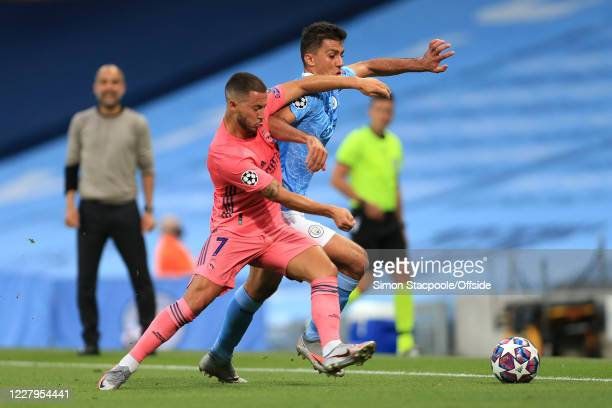 Eden Hazard of Real Madrid and Rodri of Man City during the UEFA Champions League round of 16 second leg match between Manchester City and Real...
