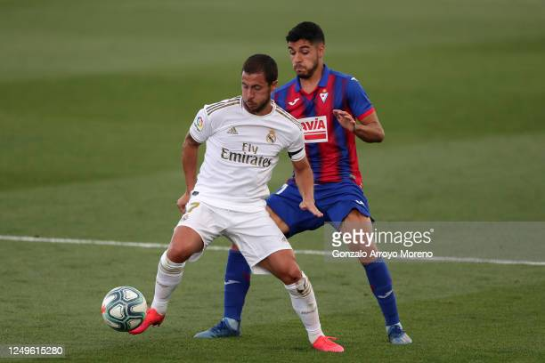 Eden Hazard of Real Madrid battles for possession with Rafa Soares of Eibar during the Liga match between Real Madrid CF and SD Eibar SAD at Estadio...